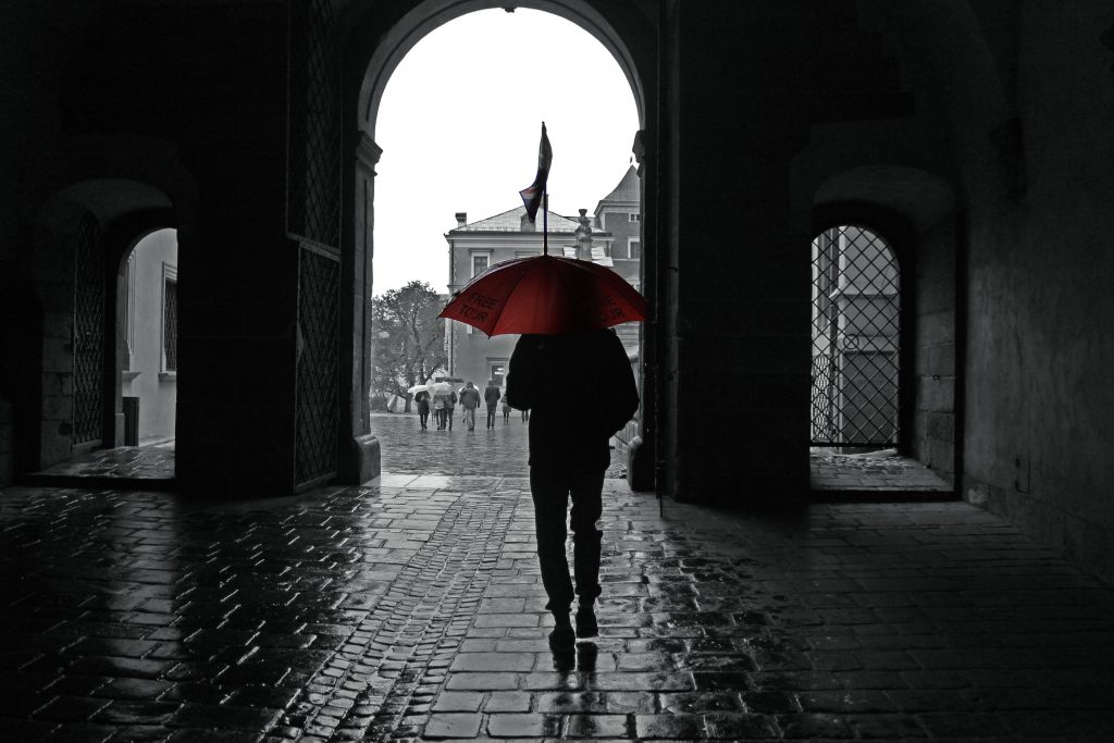 Following the red umbrella